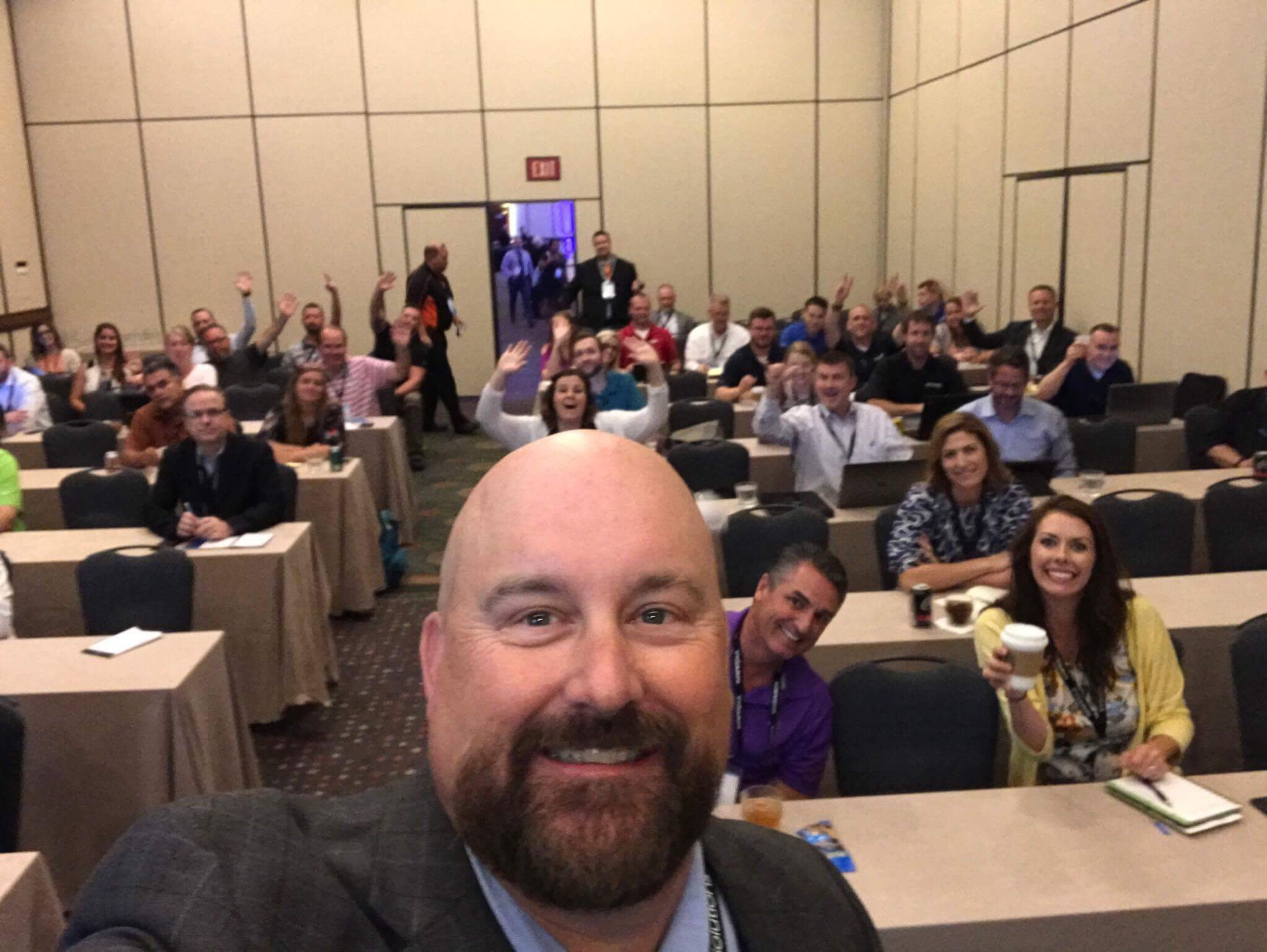 Performance Manager Scott Reagan and his breakout session attendees take a break from learning how to become their dealership's digital rock star to pose for a selfie.